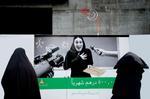 Jeffris Elliott: Muslim Women Viewing Lottery Poster, 2008