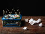 Justine Reyes: Still Life with Lunch Box and Eggshells