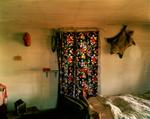 Steve Fitch: Bedroom in a house in Grassy Butte, western North Dakota, May 17, 2001